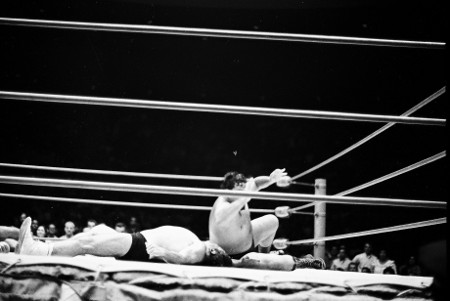 Curtis Iaukea about to cover the Magnificent Maurice.