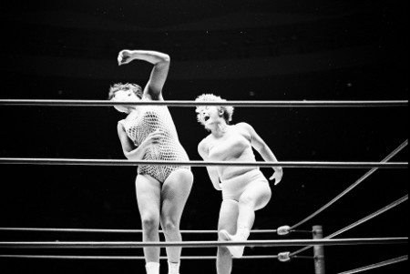 Betty Nicalli and Jean Antone collide in the middle of the ring.