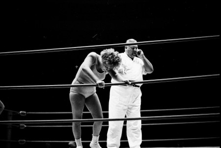 Jean Antone takes a breather on the ropes.