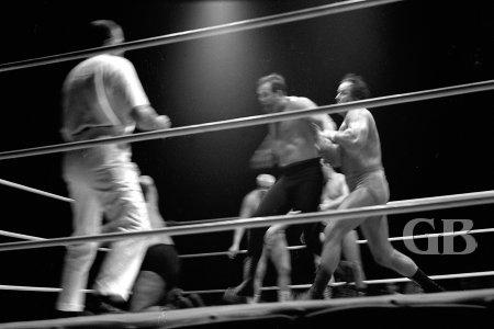 Johnny Barend throws Dutch Schultz into the corner turnbuckle.