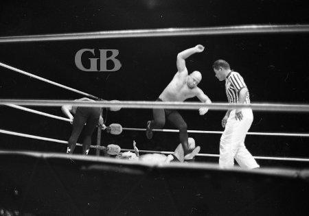 The von Steigers take turns beating up on Bockwinkel.
