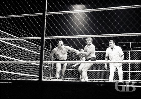 Maurice attempts to throw Hady into the cage wire.