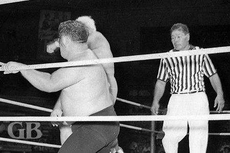 Referee Wally Tsutsumi monitors the situation as the blood starts flying.