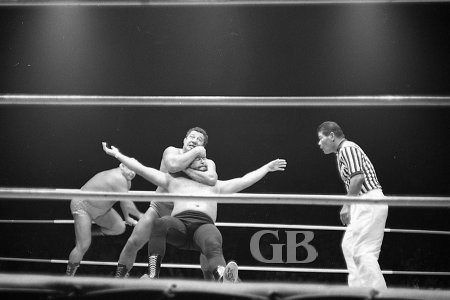 Jim Hady puts the Sleeper Hold on Dutch Schultz as Ripper Collins attempts a rescue.