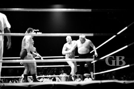 Lord Blears holds Collins in the corner for Hady, White Wolf, and Kozak.