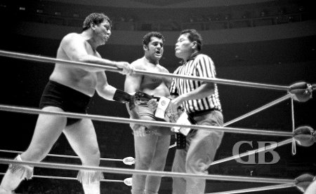 Wahoo and Morales feel the belts are theirs while referee Wally Tsutsumi begs to differ.