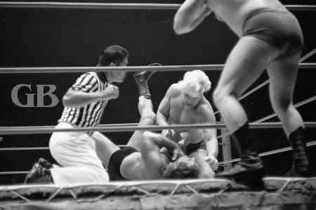 Nick Kozak being choked in the corner by Pat Patterson.