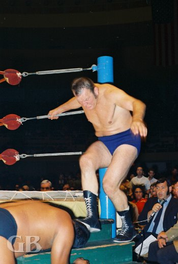 Big Gene Kiniski stomps on Sam Steamboat on the ring stairs