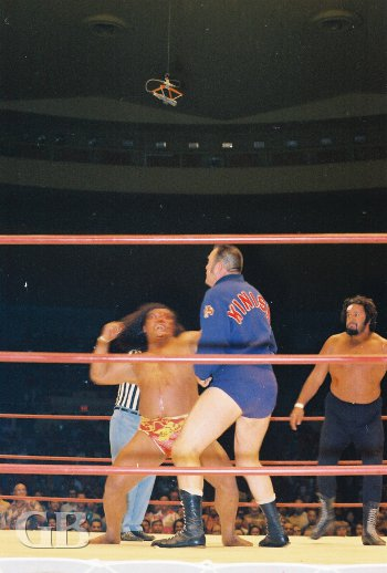Peter Maivia about to bash an interfering Kiniski with Curtis Iaukea still in the ring