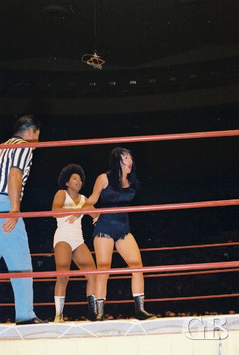 Sandy Parker has control of Toni Rose from behind