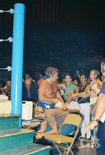 The Sheik takes a breather outside the ring among the irate fans