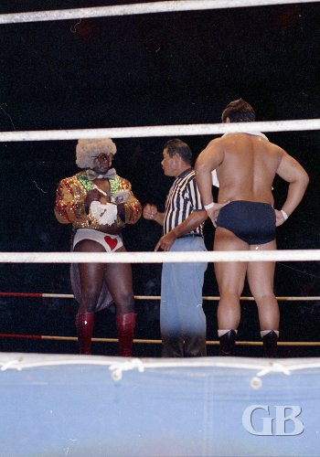 Sweet Daddy Siki goes over the rules of the match with referee Wally Tsutsumi
