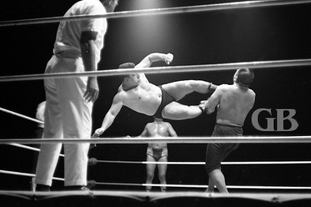 Jim Hady lands a perfect Drop Kick on Kenji Shibuya.