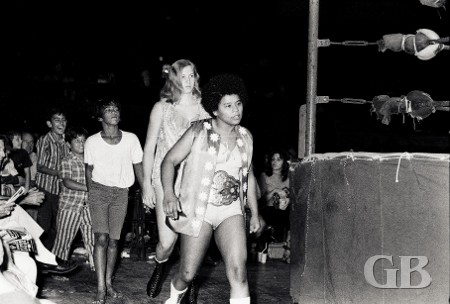 Sandy Parker and Susan Green approach the ring followed by their fans
