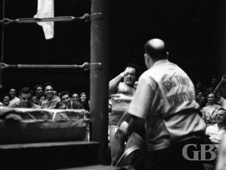 A dazed Johnny Barend staggers around outside the ring.