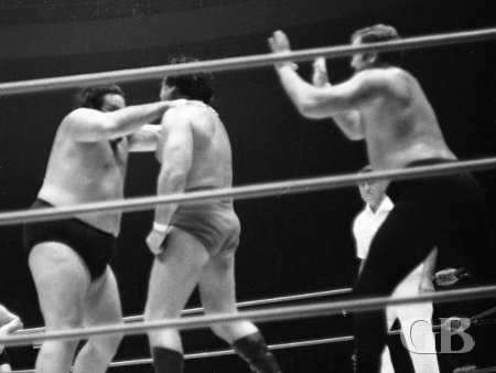 Curtis Iaukea chokes Johnny Barend as Dutch Schultz attacks from behind.