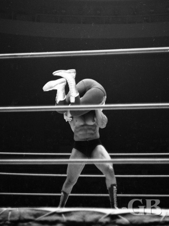 Art Thomas lifts Killer Kowalski off his feet.