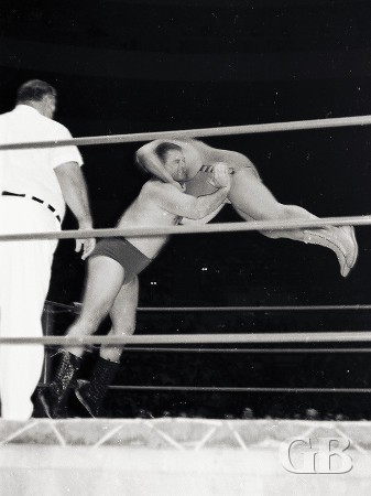 Cowboy Bill Watts about to throw Ripper Collins across the ring.
