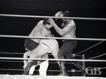 Cyclone Negra breaks up Jim Hady's submission hold on Tarzan Tyler.