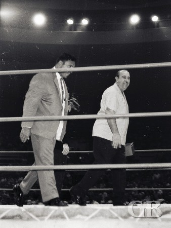 Chief Billy White Wolf arrives in the ring in a business suit.