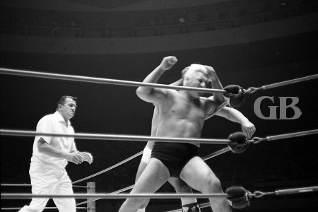 Bashing Blassie's head into the turnbuckle.
