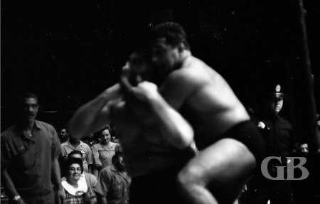 Jim Hady applies the Sleeper Hold onto a weary Bill Miller outside the ring.