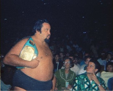 Curtis Iaukea approaches the ring with his belt.