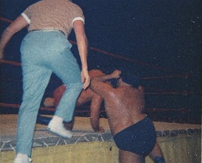 Iaukea pressed the action from outside the ring.