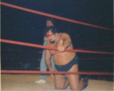His head cut open, Iaukea slowly tried to get up from the mat.