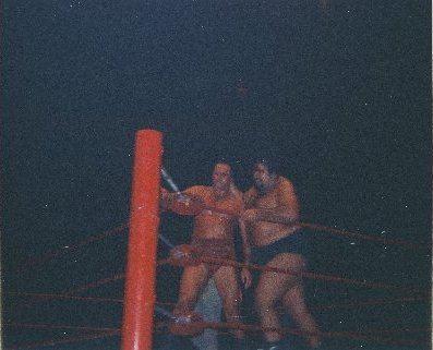 Iaukea slams Barend into the turnbuckle.