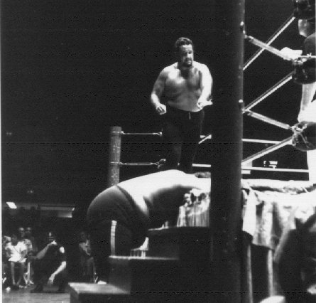 Iaukea goes after Monsoon outside the ring