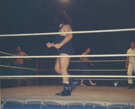 Link paces in the ring as Shibuya and Kowalski pace outside the ring.