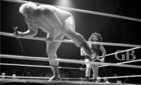 Pampero Firpo, AKA The Missing Link, runs Ripper Collins out of the ring between matches.
