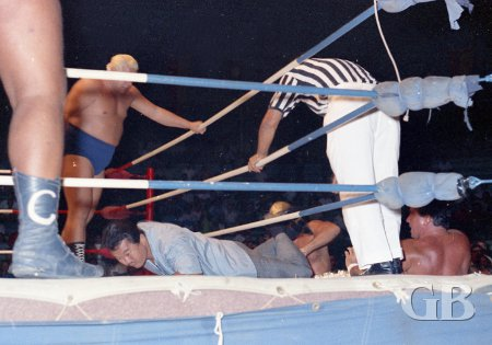 Harry Fujiwara, in street clothes, gets sucked into the opening of the match with Barend and Mortier outside the ring.