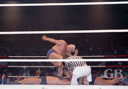 Curtis Iaukea holds Johnny Barend down as Ripper Collins stomps away.