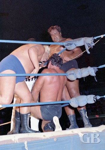 Collins and Iaukea gang up on Barend in the corner.