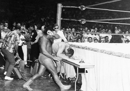 Pedro Morales slams the Sheik into the table