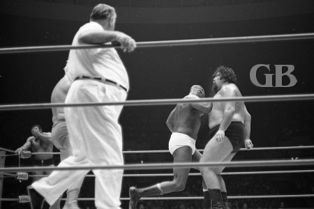 Bearcat Wright lands a solid elbow to the chest of Curtis Iaukea.