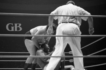 Curtis Iaukea cranks up the pain on Bearcat with his nerve hold.